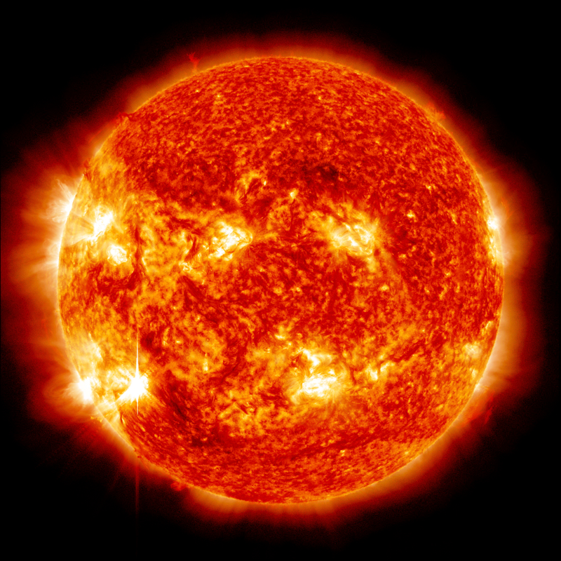 Rysunek przedstawia zdjęcie czerwono pomarańczowej tarczy słonecznej.